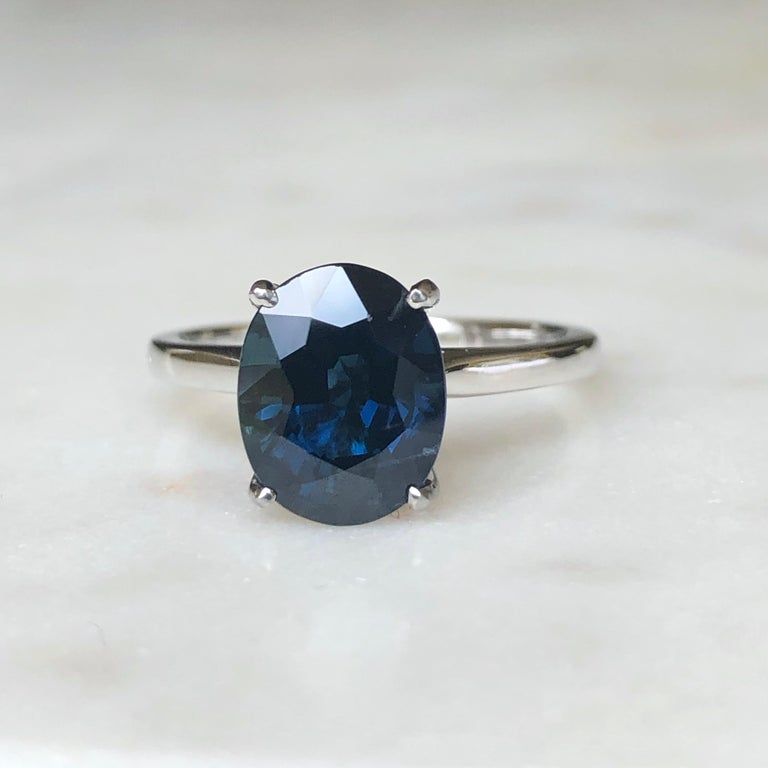 Stunning solitaire natural sapphire engagement ring. Set to centre with a natural oval cut deep blue sapphire with an approximate weight of 3.8 carats in an open back claw platinum setting. This gorgeous engagement estate ring weight 5.1 Grams.