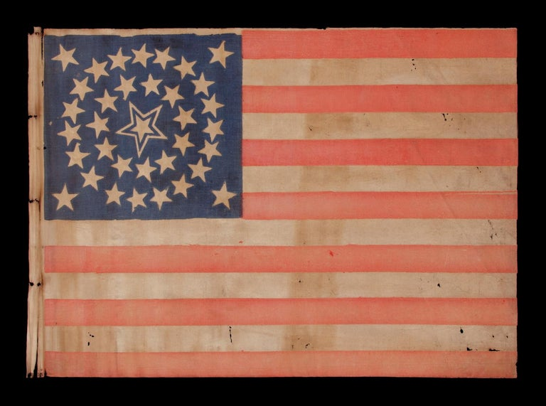 35 STARS IN A MEDALLION CONFIGURATION WITH A LARGE, HALOED CENTER STAR, CIVIL WAR PERIOD, WEST VIRGINIA STATEHOOD, 1863-65   35 star American national parade flag, printed on cotton. The stars are arranged in what is known as a medallion