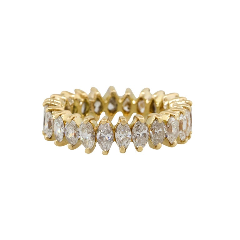 Material: 18k Yellow Gold Diamond Details: Approximately 3.50ctw marquise diamonds. Diamonds are H/I in color and SI1 in clarity. Ring Size: 6 (can be sized) Total Weight: 5.9g (3.7dwt) Measurements: 0.80