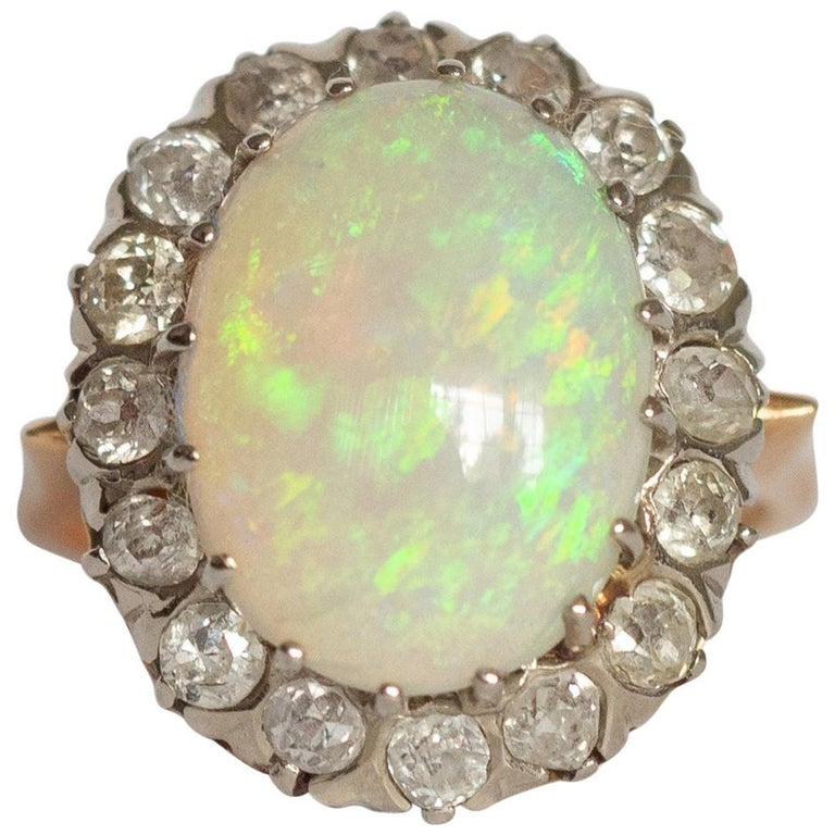 3.50 Carat Opal Yellow Gold and White Gold Prongs For Sale