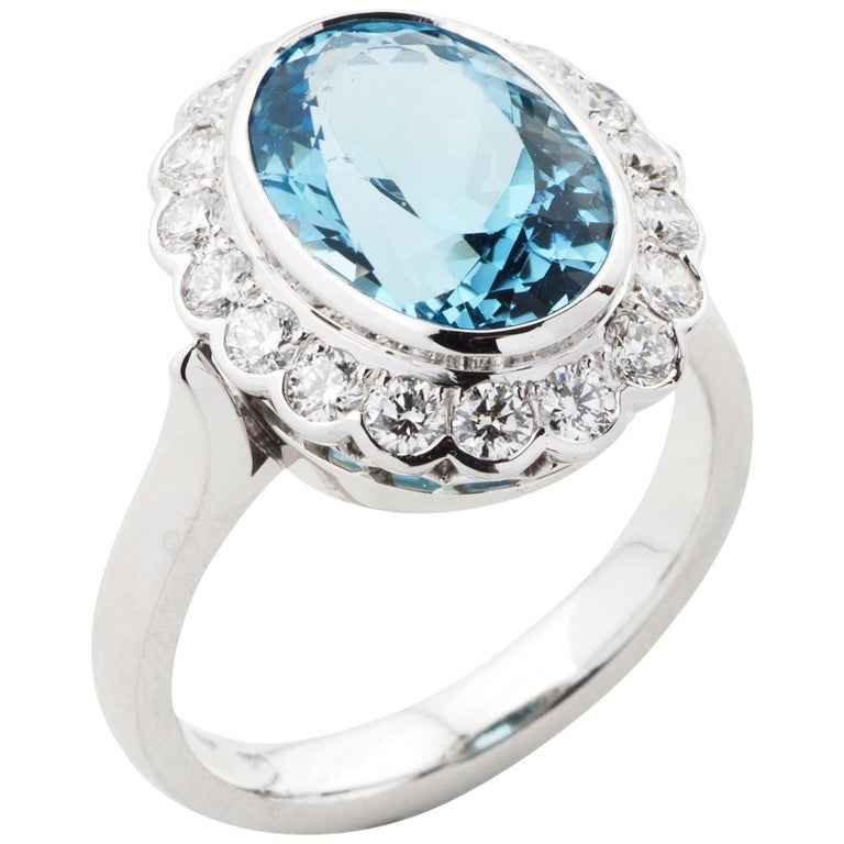3.50 Carat Oval Cut Aquamarine and Diamond Cluster Ring in 18 Karat White Gold For Sale