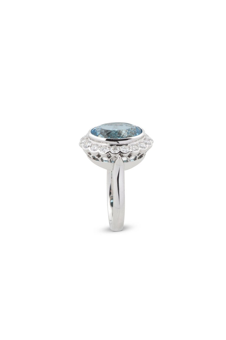 Modern 3.50 Carat Oval Cut Aquamarine and Diamond Cluster Ring in 18 Karat White Gold For Sale