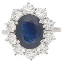 3.50 Carat Oval Sapphire and Ten Diamond Round Brilliant Cluster Ring, Modern
