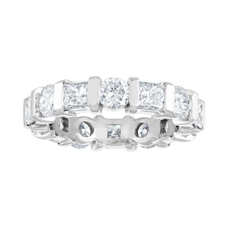 Beautiful Eternity Band with Alternating Round & Princess Diamonds The ring is 18KW Gold. There are 1.80 Carats In Round Diamonds G/H VS There are 1.70 Carats In Princess Diamonds G/H VS The ring weighs 5.4 grams The ring is a size 5.5, cannot be