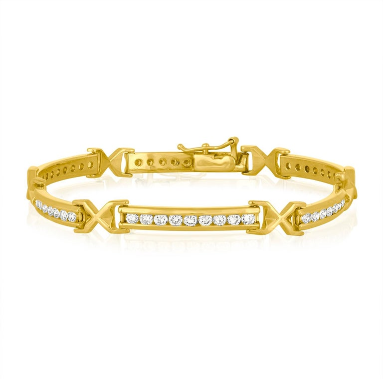 The bracelet is 14K Yellow Gold There are 3.50 Carats In Diamonds F VS There are 54 stones Each stone is 0.06 Carats The bracelet weighs 13.7 grams The bracelet is 7.25