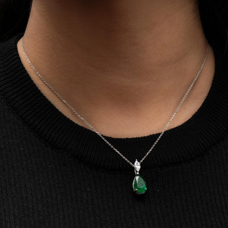 3.50ct Pear shape natural emerald with a 0.45ct Marquise shaped diamond set in an 18K white gold pendant.   Diamond quality: D-E color, VS1-VS2 clarity