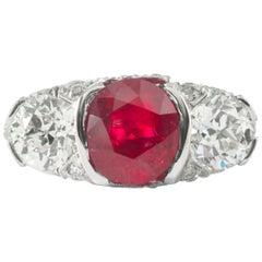 3.52 Carat Antique Cushion Unheated Burma Ruby and Diamond 3-Stone Platinum Ring