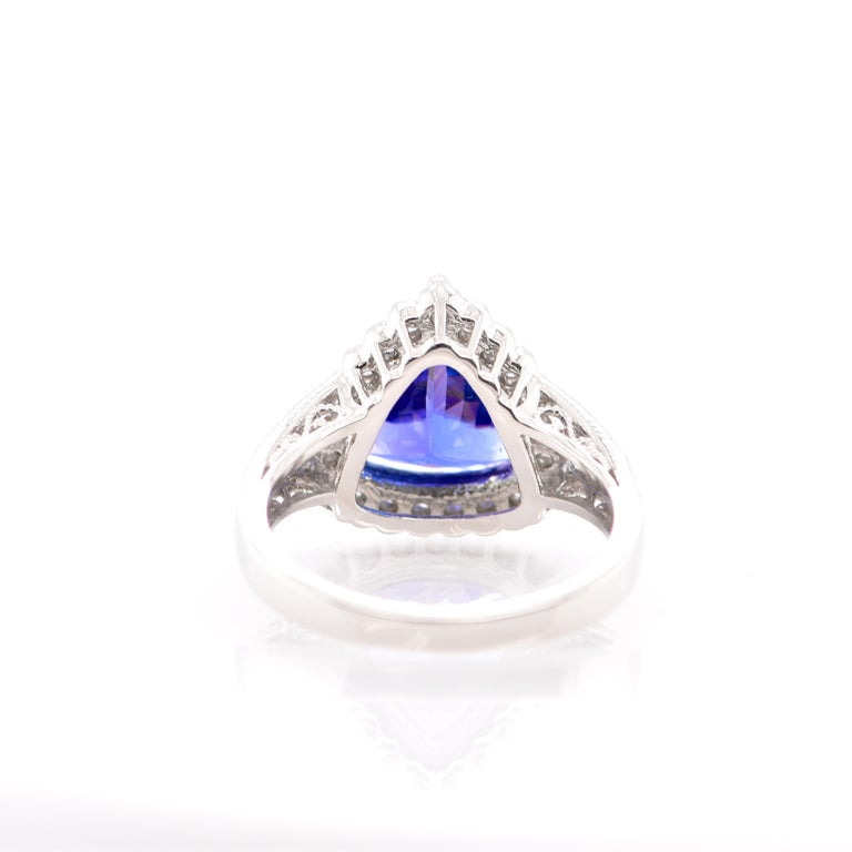 A beautiful Cocktail Ring featuring a 3.52 Carat Trillion Cut Tanzanite and 0.37 Carats of Diamond Accents set in Platinum. Tanzanite's name was given by Tiffany and Co after its only known source: Tanzania. Tanzanite displays beautiful pleochroic
