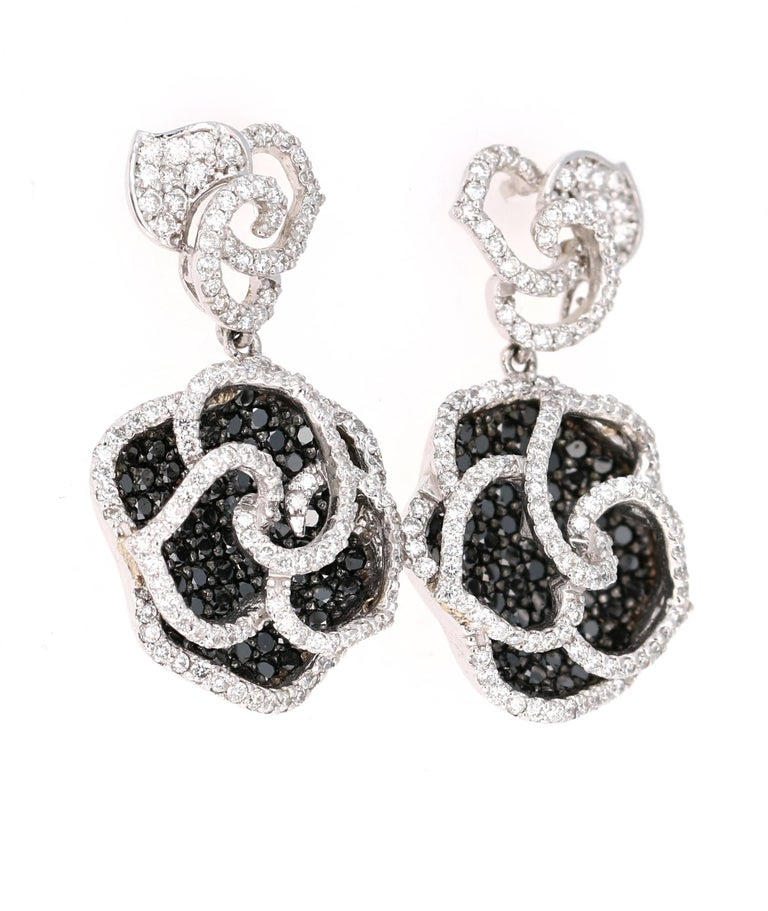 Stunning Black and White Diamond Earrings that are nothing less than a Statement! Beautiful Black Roses for your jewelry collection!  The ring is adorned with 160 Black Diamonds that weigh 1.98 Carats as well as 280 Round Cut Diamonds that weigh