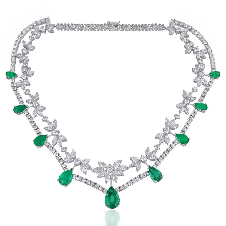 Cast from 18-karat gold, this exquisite earrings, necklace, ring set is embellished with 25.01 carats Emerald and 35.40 carats of sparkling diamonds.  The price is for set, however you can also buy each piece individually.  FOLLOW MEGHNA JEWELS