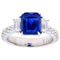 3.55 Carat Emerald Cut Sapphire Ring with Trapezoid Diamonds and Diamond Band