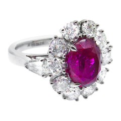 Platinum 3.57 Carat Oval Mozambique Ruby and White Diamond Cluster Ring