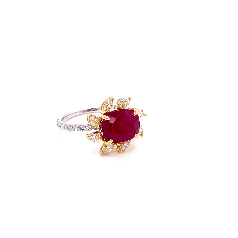 3.58 carat GRS Certified Unheated Burmese Ruby and Diamond Gold Engagement Ring:  A rare ring, it features a stunning unheated Burmese ruby weighing 3.58 carat, surrounded by a unique halo of yellow diamonds weighing 0.47 carat, and white round