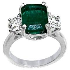 3.6 Carat Emerald Cut Emerald and 1.06 Carat Diamond Ring Platinum