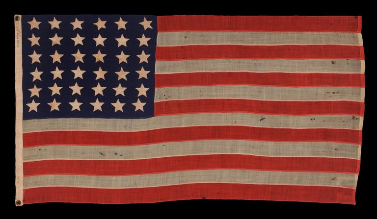36 STARS ON AN ANTIQUE AMERICAN FLAG OF THE CIVIL WAR ERA, ENTIRELY HAND-SEWN, MADE BY ANNIN IN NEW YORK CITY; DESCENDED IN THE FAMILY OF MAJOR CHARLES HARROD BOYD OF PORTLAND, MAINE, A SURVEYOR ENGINEER FOR BOTH THE U.S. NAVY UNDER COMMODORE