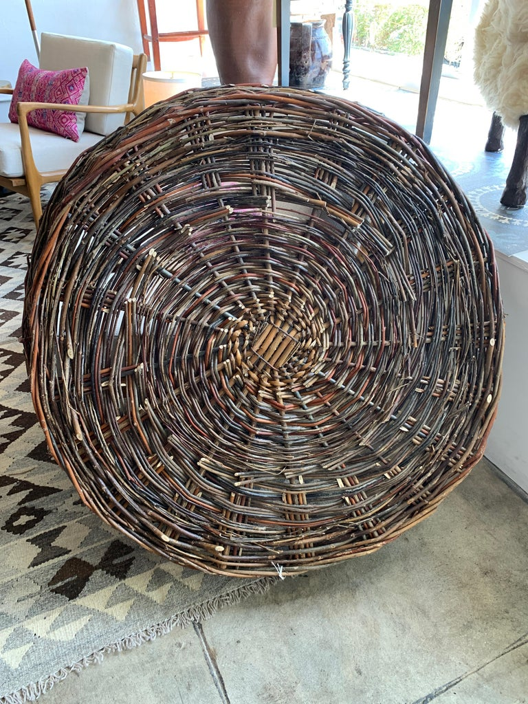Large, flat-woven basket from Europe. Makes a wonderful wall decoration but could also be used to collect homegrown fruits and vegetables for easy harvesting. Measures: 36
