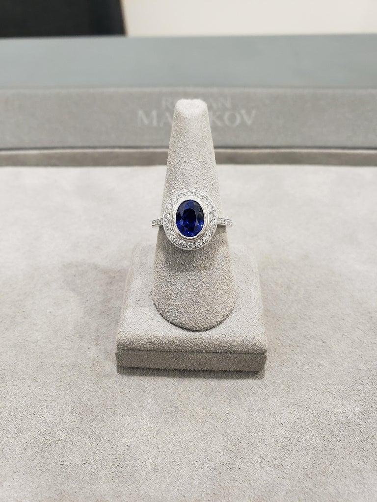Oval Cut 3.60 Carat Blue Sapphire Diamond Halo Ring For Sale