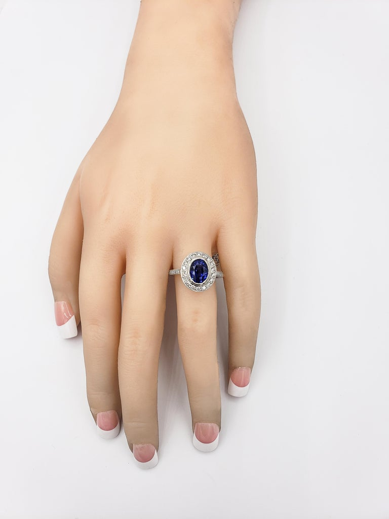 3.60 Carat Blue Sapphire Diamond Halo Ring For Sale 1