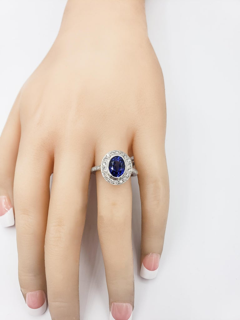 3.60 Carat Blue Sapphire Diamond Halo Ring For Sale 2