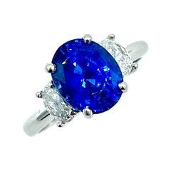 3.60 Carat Oval Sapphire and Oval Diamond Three Stone Platinum Ring