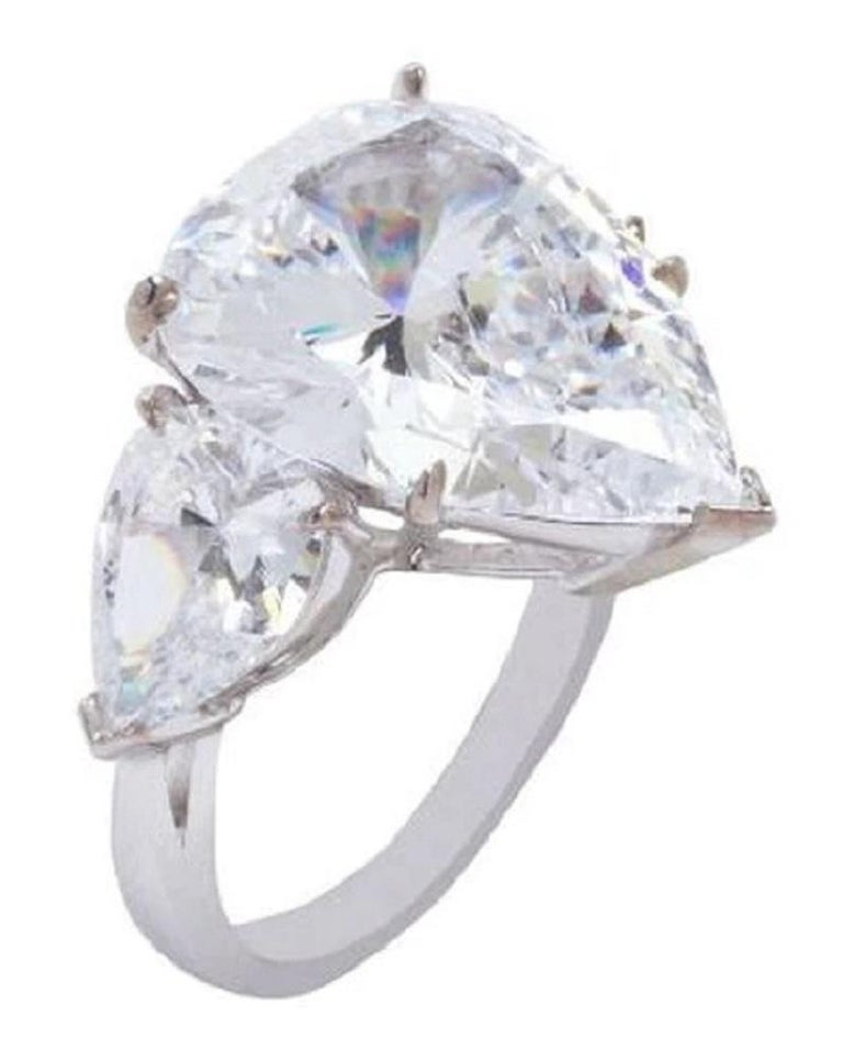 An exquisite ring composed by a main stone with a 3 carat center stone plus two side pear cut diamonds of approximately 0.30 carats each