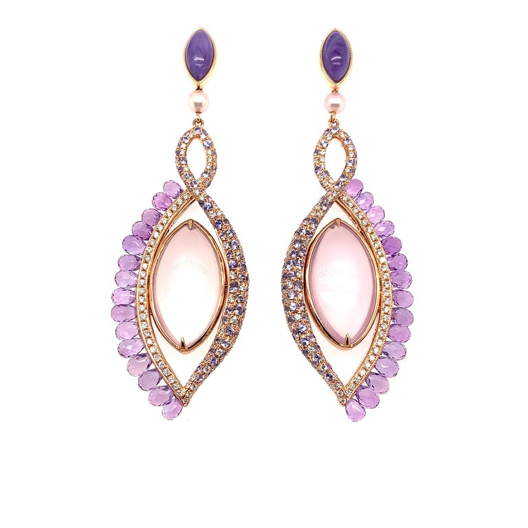 Eye Candy Collection - this collection was inspired by the uniqueness of every human eye and the beauty they behold. These earrings are able to rotate 360°, and this movement makes them trendy and super fun to wear! One side features the most