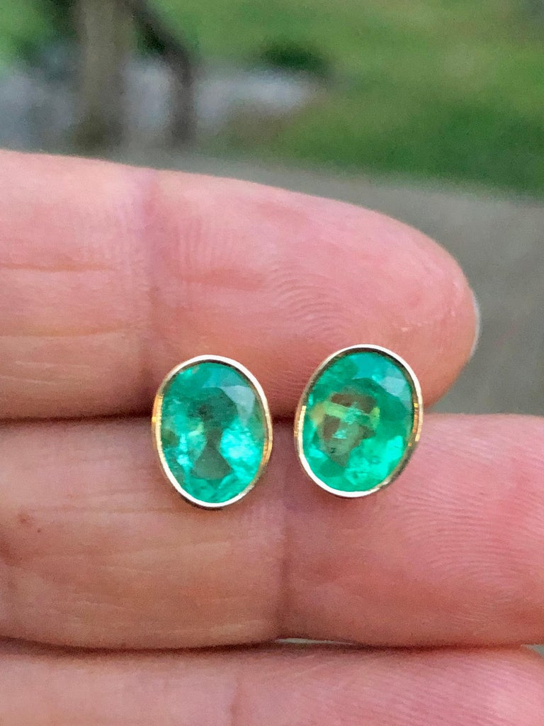3.63 Carat Natural Colombian Emerald Oval Stud Earrings 18k Yellow Gold Primary Stones: 100% Natural Colombian Emeralds Shape or Cut : Oval Cut Average Color/Clarity : Medium Green/ Clarity, VS-SI  Total Weight Emeralds: 3.63 Carats  Earrings