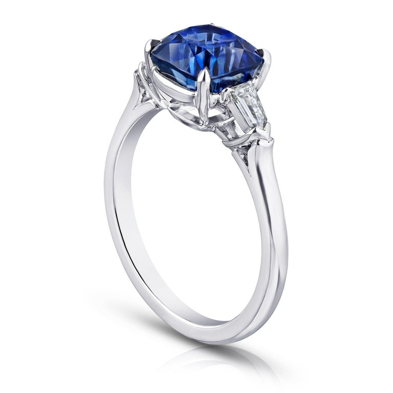 3.65 carat cushion blue sapphire with bullet shape diamonds .27 carats set in a platinum ring.