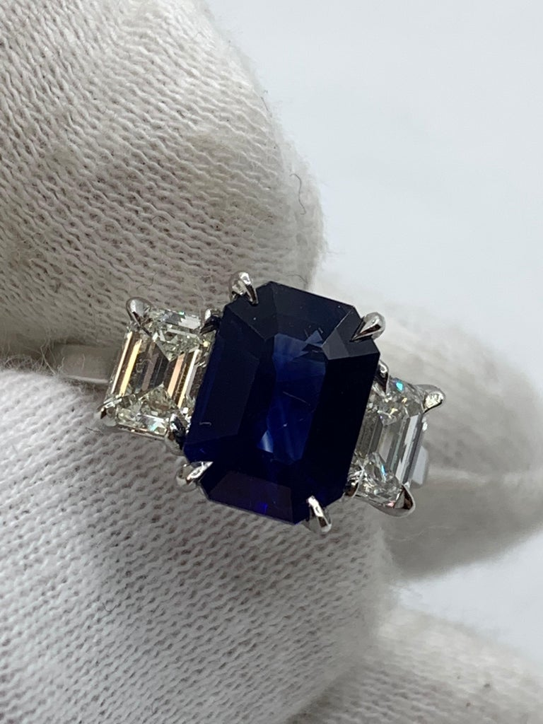 Modern GIA Certified 3.65 Carat Emerald Cut Blue Sapphire and Diamond Three-Stone Ring For Sale