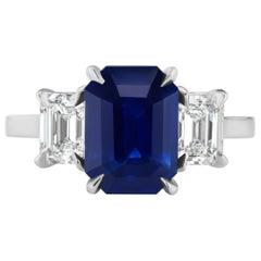 3.65 Carat Emerald Cut Blue Sapphire and Diamond Three-Stone Ring