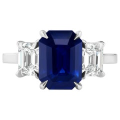3.65 Carat Emerald Cut Blue Sapphire and Diamond Three-Stone Ring