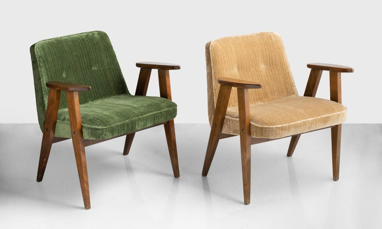 366 armchairs by Jozef Chierowski, Poland, circa 1960.  Simple, modernist, slightly petite form with original beechwood frame and newly upholstered cushions in striped velvet.