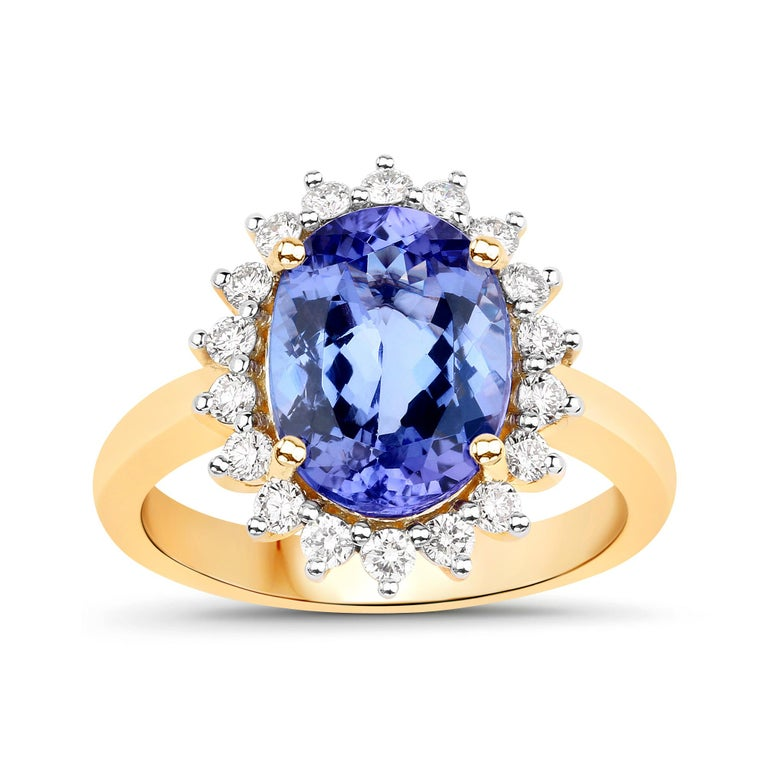 3.67 Carat Oval-shaped Tanzanite and 0.45 Carats White Diamond 14 Karat Yellow Gold Ring  Center Stone Details: Stone: Tanzanite Shape: Oval Size: 11.05x7.40mm Weight: 3.12 carat  Diamond Details: Shape: Round Brilliant (78) Carat Weight: 0.51