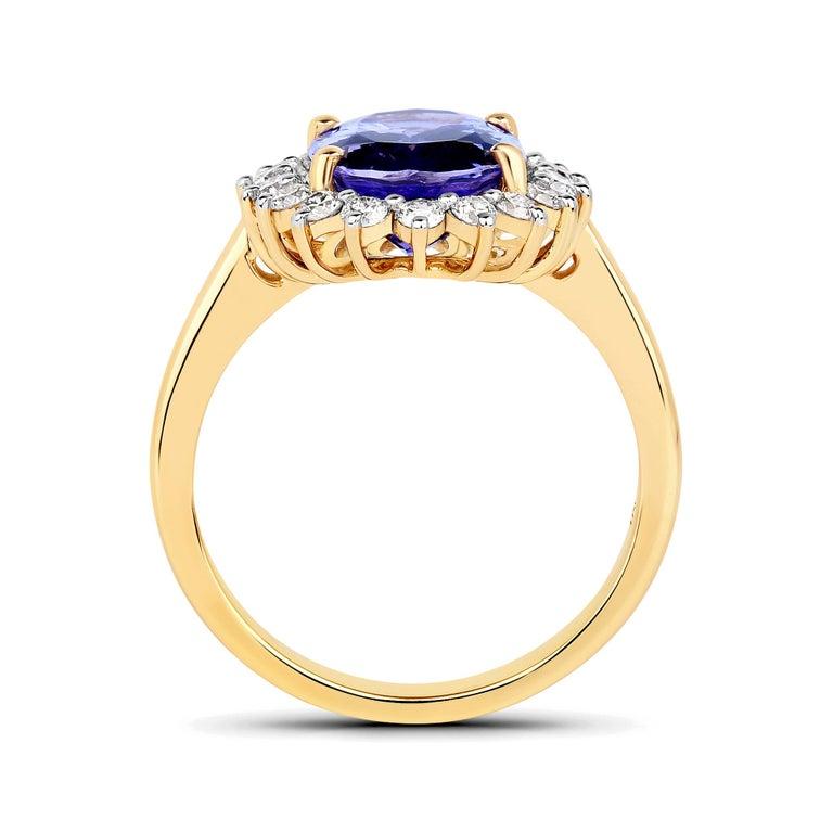 Contemporary 3.67 Carat Genuine Tanzanite and White Diamond 14 Karat Yellow Gold Ring For Sale