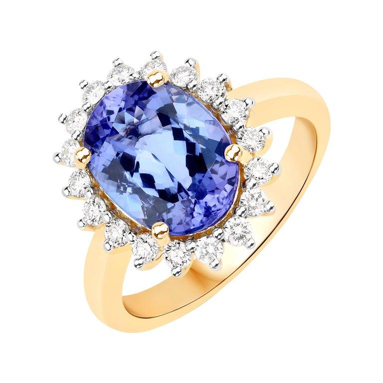 3.67 Carat Genuine Tanzanite and White Diamond 14 Karat Yellow Gold Ring For Sale