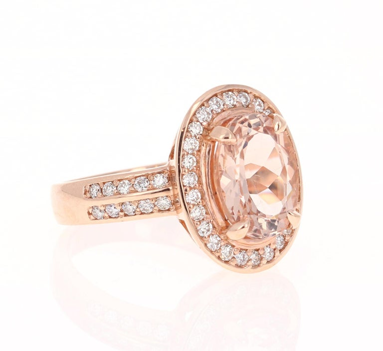 This Morganite ring has a beautiful 3.11 Carat Oval Cut Morganite and is surrounded by a halo and diamonds on the shank of 46 Round Cut Diamonds that weigh 0.57 Carats. The diamonds have a clarity and color of VS-H. The total carat weight of the
