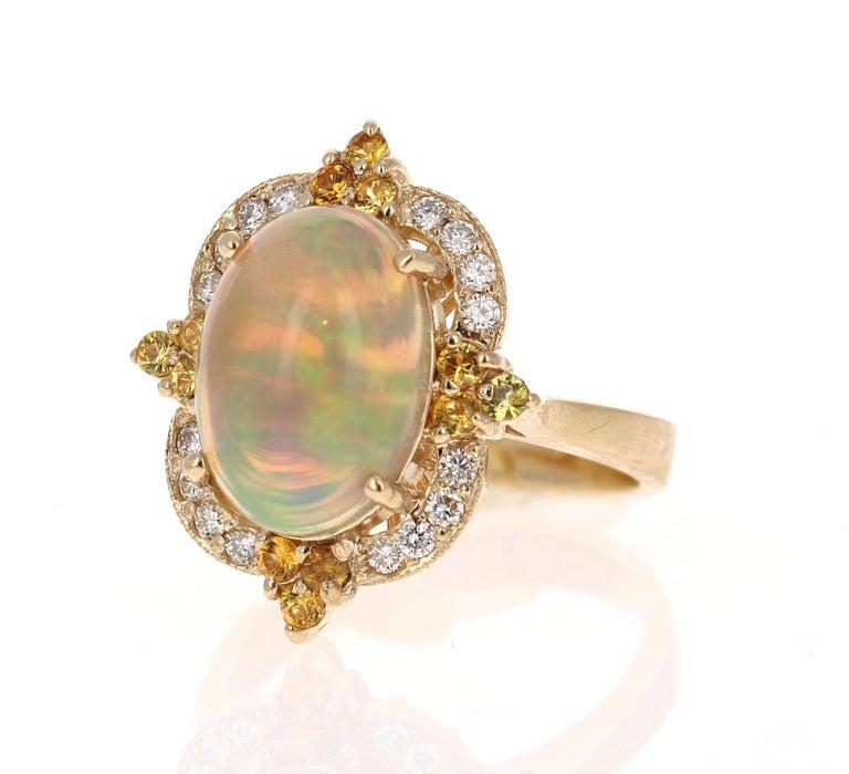 Modern 3.68 Carat Opal Sapphire Diamond 14 Karat Yellow Gold Ring For Sale
