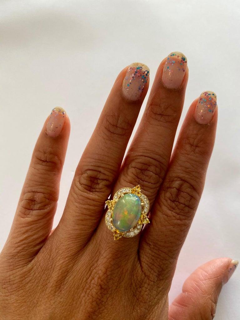 Oval Cut 3.68 Carat Opal Sapphire Diamond 14 Karat Yellow Gold Ring For Sale