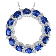 3.68 Carat Oval Cut Blue Sapphire and Round Diamond Pendant