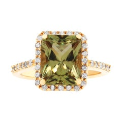 3.7 Carat Radiant Color Changing Diaspore and White Diamond Ring
