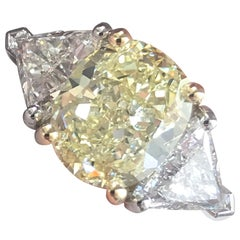3.7 Carat TW Fancy Light Yellow Oval Diamond Engagement Ring with Trillions