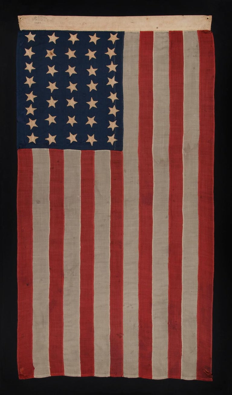 37 star antique American flag, entirely hand sewn and in an attractive, small scale for the period, made by Joseph H. Foster in Philadelphia between 1867-1876, the period when Nebraska was the most recent state to join the union: