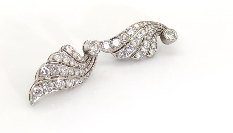 How fabulous! These statement earrings are for women who have elegance & sophistication. Still fashionable and stylish even though they look like they are out of the pages of a 1950's magazine. Beautifully handcrafted in platinum, these wing style