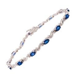 3.70 Carat Oval Blue Sapphire and Round Diamond Tennis Bracelet in 14 Karat Gold