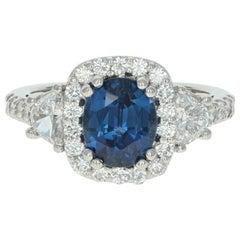 3.73 Carat Oval Cut Sapphire and Diamond Ring, Platinum Halo Half Moon Accents