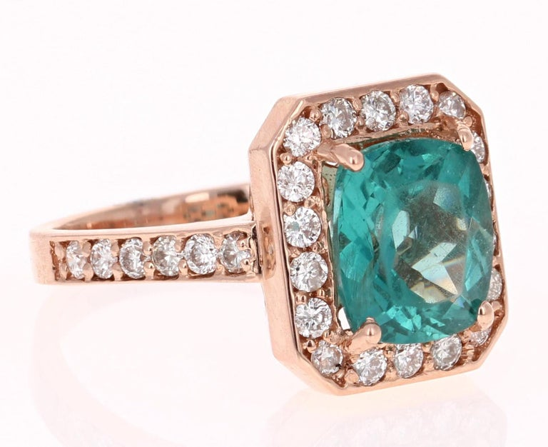 An Apatite Ring set beautifully in Rose Gold - such a beautiful and unique combination!!  This stunning Apatite and Diamond Ring can easily transform into a unique and classy engagement ring for your special someone!  The ring has a 3.01 Carat