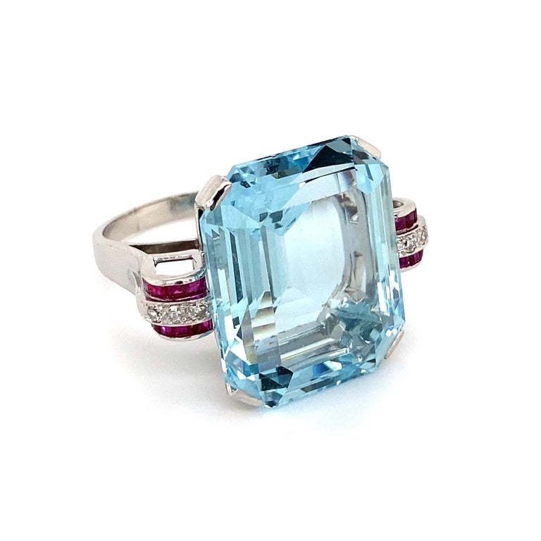 37.50 Carat Aquamarine Ruby and Diamond Platinum Cocktail Ring Estate Fine Jewelry Simply Beautiful! Aquamarine and Diamond Platinum Ring. Center securely set with an Aquamarine weighing 37.50 Carat. Both sides of ring Hand set with Rubies, approx.