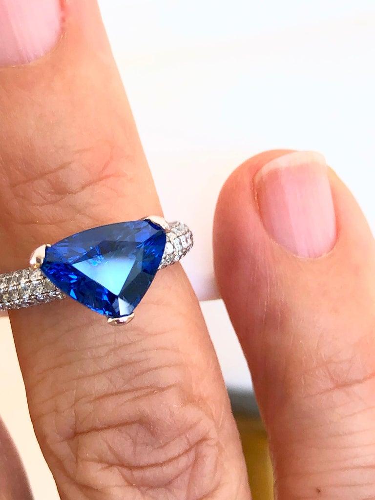 3.76 Carat Estate Sapphire & Diamond Wedding Engagement Ring 18k White Gold Primary Stone: Natural Sapphire Sapphire Weight: 3.46 Carats  Shape or Cut Sapphire: Trillion Average Color & Clarity Sapphire: Fine Sapphire Vivid Cornflower Blue /VS