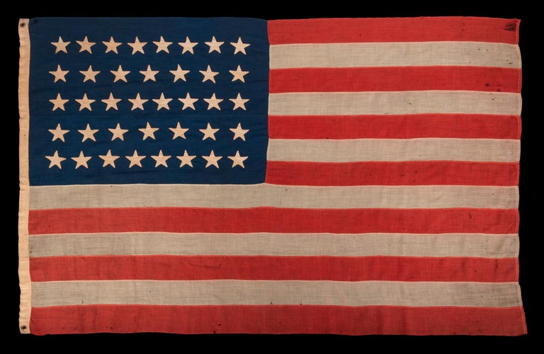 38 Star Antique American Flag with Hand-sewn Stars in an 8-7-8-7-8 Pattern of Justified Rows, Made in the Period When Colorado was the Most Recent State to Join The Union, 1876-1889:  38 star American national flag, with pencil-inscribed names of
