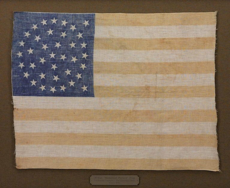 This is a striking original 38-star United States flag. A wonderful celebration of our nation's early history, this flag is an authentic antique, dating circa 1877-1890.